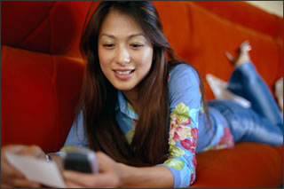 Girl On Mobile Phone. Image © Corbis.